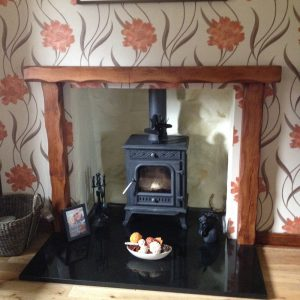Heavily Worked Oak Beam Fire Surround