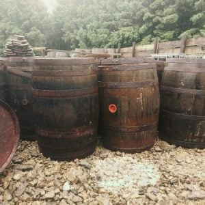 40 Gallon Whiskey Barrels with Missing Steel Bands Representation
