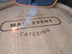 Laser engraved wine barrel with logo of main event catering