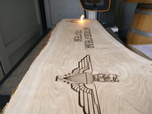 SAS Bar Sign laser engraving in progress