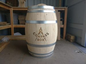 Compass Box logo engraved on to a Wine Barrel