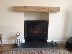Lightly Worked Oak Beam above Fireplace