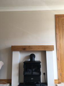 Contemporary Finish Oak Beam with Danish Oil above Log Burner