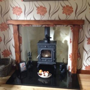 Heavily Worked Fire Surround With Cast Iron Stove