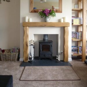 Heavily Worked Oak Fireplace Surround in modern Living Room