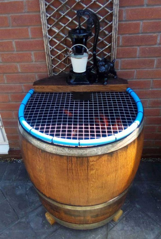 Wine Barrel Planter Used as Fish Pond Water Feature