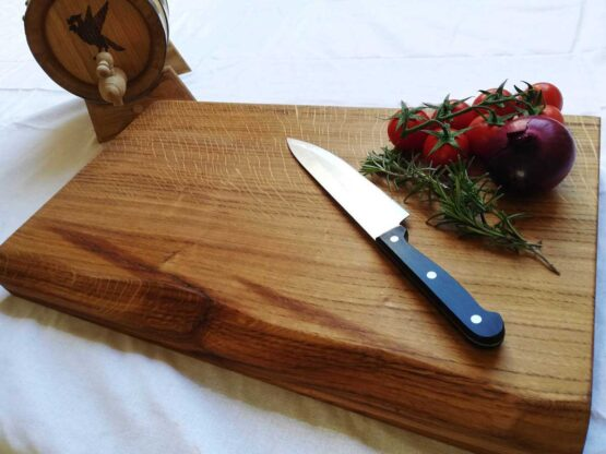 James Martin Style Live Edge Chopping Board Displayed with Tomatoes and Rosemary