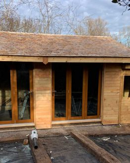 Second Grade Larch Cedar Cladding in Situ